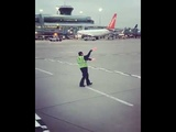 Airline Worker Ecstatic Dancing On Tarmac