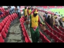 Senegal fans cleaning their section before leaving the stadium after their historic victor