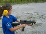 8 year old girl shoots full auto MAC 10 with Mom & Dad