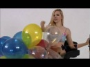 LOONER GIRL POPPING THE BALLOONS SIT ON CHAIR