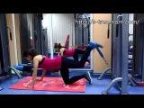 Упражнение для ног и ягодиц: Махи ногами назад вверх в кроссовере (нижний блок)