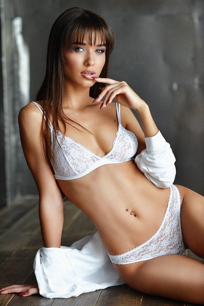 Lewd virgin in erotic underware showing off