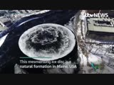 This stunning disc of ice is rotating on a river in the US, after it formed on top of a whirlpool. - - More