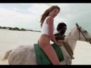 Women ride in the beach