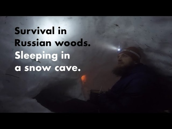 Sleeping in a snow cave. Survival in Russian woods.