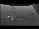 N2Y-1 training planes, with trapeze-hook equipment, practice hooking onto USS Ak...HD Stock Footage