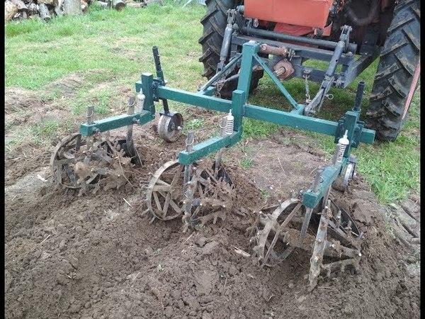 Трактор Т-16. Прополка картофеля самодельными ежами.