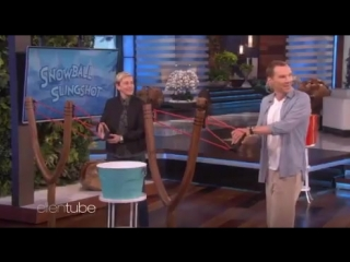 benedict cumberbatch and ellen degeneres playing snowball slingshot' with a lucky person of the audience.