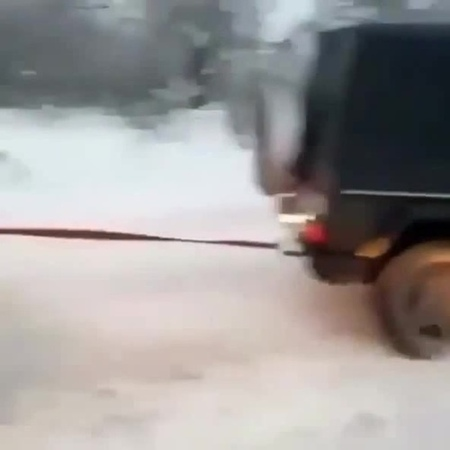 Mercedes G63 AMG towing a truck
