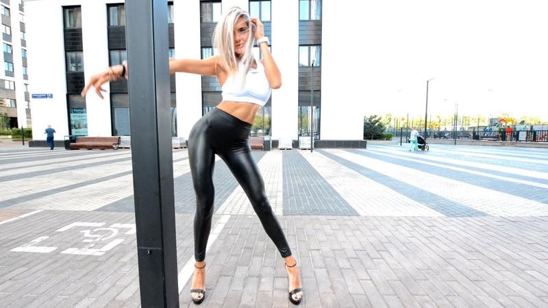 Fitness motivation. Squat in leather leggings, skin, latex