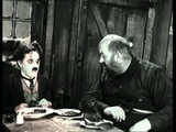 Charlie Chaplin eating his shoe The Gold Rush High Quality