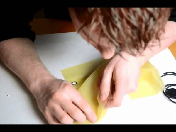 How to make latex fetishwear, tutorial 7. glueing curved seams cellphone pouch.wmv