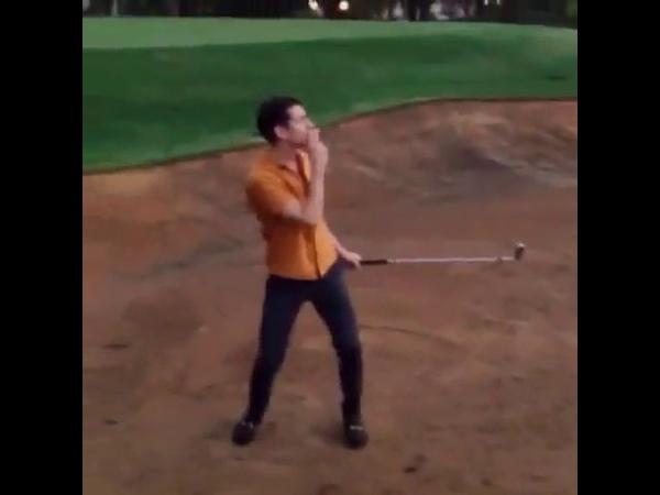Alex Turner playing golf
