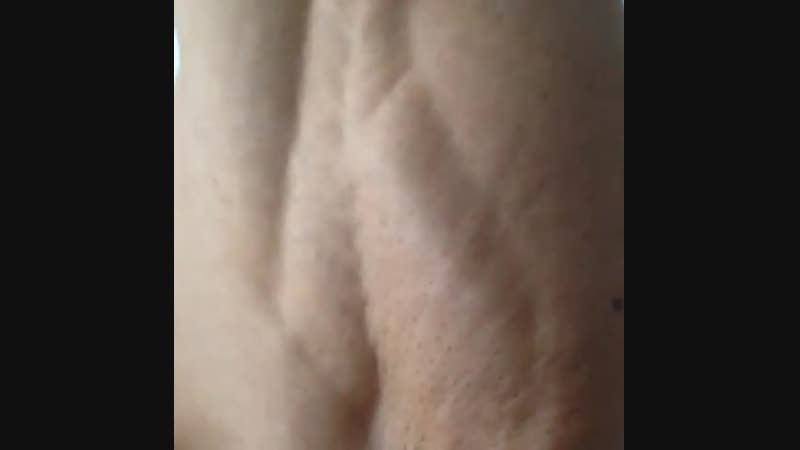 IFBB Pro Arkady Velichko quads flexing in bed