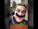 Антон Логвинов в маске с усами Марио