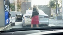 Blonde woman tries to fill up a Tesla Model S P100D