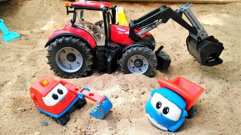 Машинки строят дорогу в песочнице. Видео на английском языке.