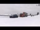 Tesla Model X тащит за собой по снегу 43-тонный грузовик 😨