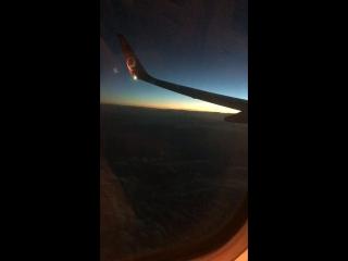 Рассвет на борту самолета
