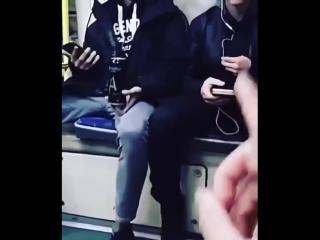 Животное в метро бросает банку в парня